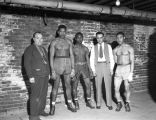 Three boxers and two trainers