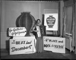 Woman with accordion standing among advertising signs