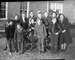 Children receiving a bicycle
