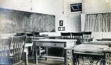 Union College classroom with sewing machine tables